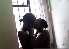 Ebony lesbians pleasure each in the bathroom and then enjoy it very much