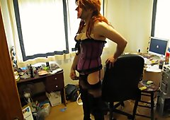 Wearing a sexy corset stockings & thigh boots
