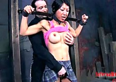 Busty Korean hooker Tia Ling gets fixed in the dark room for BDSM