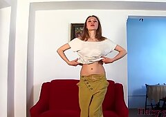 Naked slim girl with hairy armpits and vagina