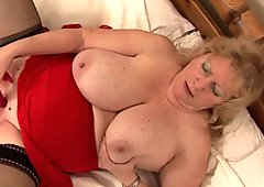 Busty grandma Fiona gets wet and dirty