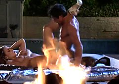 Buxom and sexy black haired nympho Nika Noir rides a cock near the pool