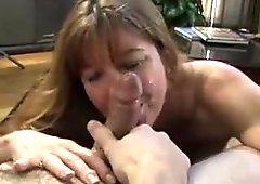 Brunette milf with big honkers sucks two stiff knobs